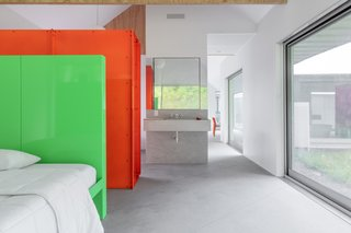 The bedroom freely flows into an open bathroom area.