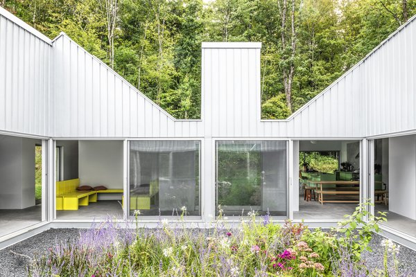 "The home spreads out from a courtyard garden in a shape that resembles a hand traced on a sheet of paper. The structure of each ""finger"" nods to the traditional gable-sided barns that dot the area."
