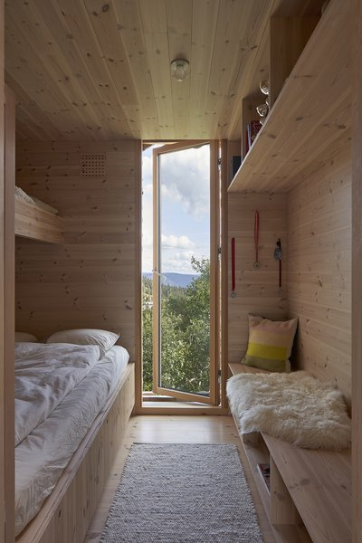 A child's bedroom has built-ins designed by Casper and Lexie and fabricated by Strønes Snekkerversksted.