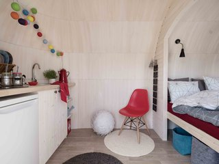 The smallest cabin measures just 16 feet long, providing space for a tiny kitchen and nook bed.