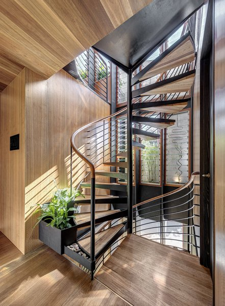 A spiral staircase runs through the center of the house, serving as a chimney that pulls cool air up from the ground floor as hot air exits through windows on the top level.