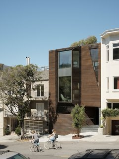 """The relatively discreet exterior, clad in cedar slats, belies the risks taken within. """"We wanted to do a facade that didn't give too much away,"""" says Ogrydziak. The street-facing windows are by Blomberg."""
