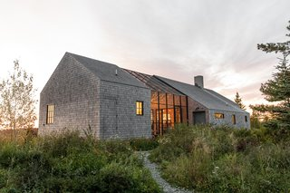 A Screened Porch Slices Through a Design Duo's New England Cottage