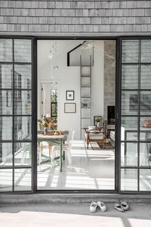 The screened-in porch leads into an open great one on one half of the structure.