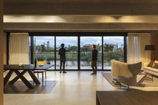 A look at the open living area of the prefab house in Canelones, Uruguay, designed by MAPA. The roof is made of precast concrete slabs more commonly used to build bridges.