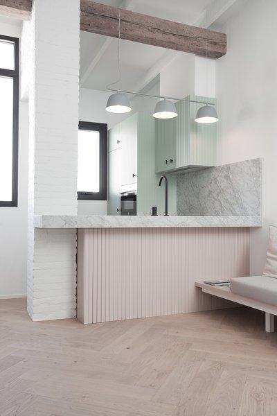 A Muuto light illuminates the newly opened kitchen.
