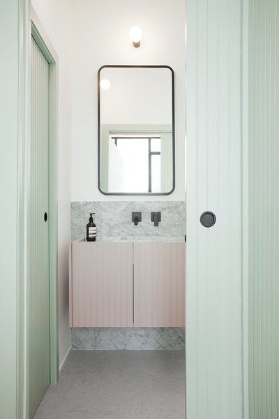 Marble punctuates the refurbished bathroom.