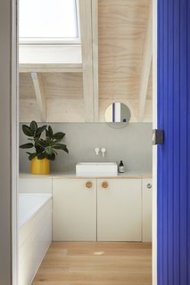 A sink by Duravit sits in the bathroom with a pan faucet by Zuchetti.