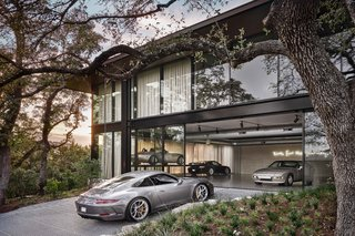 Sited on a four-acre property atop a beautiful, secluded cove in Austin, this dream garage is show-worthy inside and out.