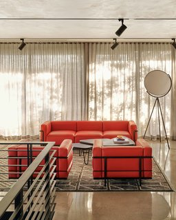 Another look at the lounge area upstairs. Sheer curtains capture a delicate, stencil-like shadow from the many trees surrounding the structure.