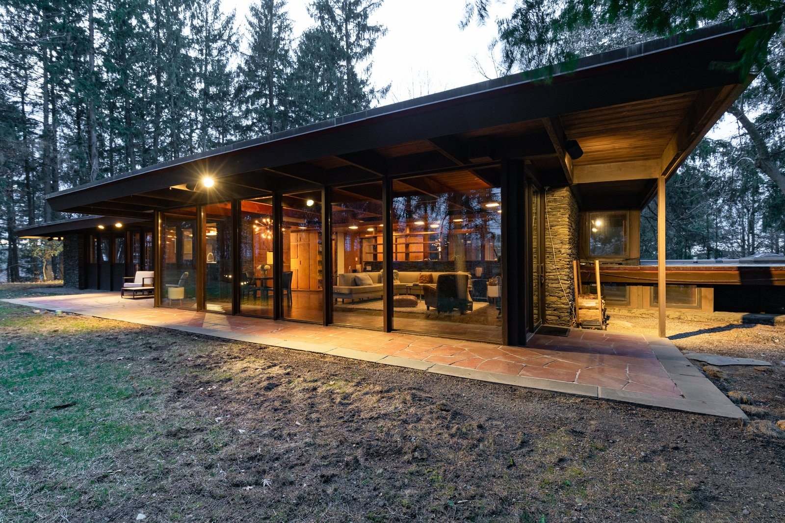 Engaged with its surroundings inside and out, the Calabi-Picker House blends classic Usonian architecture with the serenity of a secluded mountain retreat.  Photo 8 of 8 in A Midcentury Retreat by Architect and Usonia Founder Aaron Resnick Lists for $999K