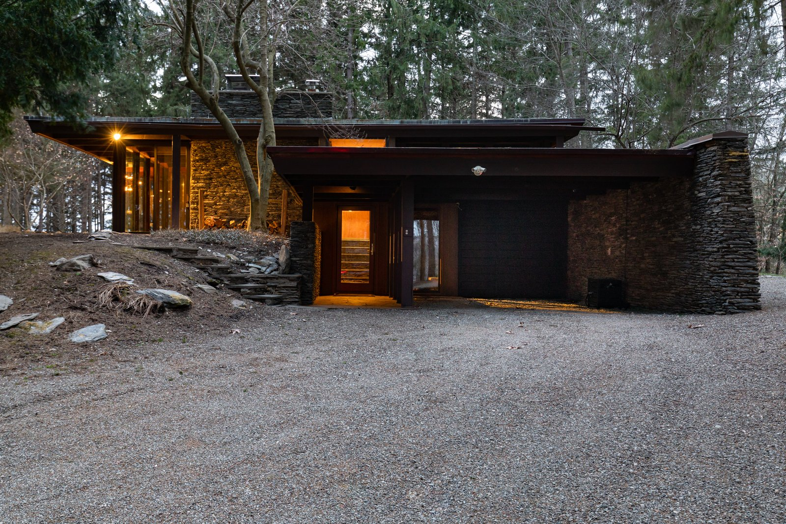 Together with fellow architect David Henken, Aaron Resnick designed many of the Frank Lloyd Wright-inspired homes in the midcentury enclave of Usonia in Westchester County, New York. Resnick also designed other nearby homes  Photo 1 of 8 in A Midcentury Retreat by Architect and Usonia Founder Aaron Resnick Lists for $999K
