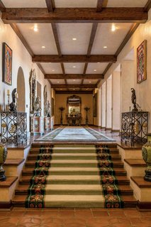 An ornate, main-level hallway stretches 82 feet.