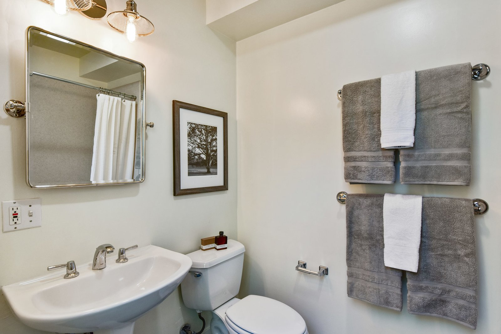 A peek at the master bathroom, which also offers a large shower.  Photo 7 of 9 in A Converted Warehouse Loft in the San Francisco Bay Area Seeks $950K