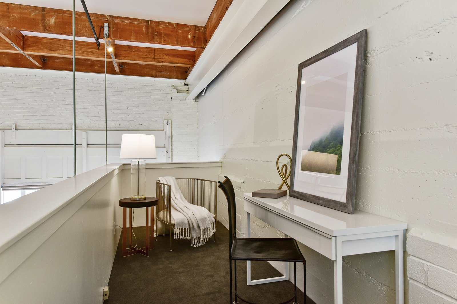 A cozy balcony area off the bedroom can serve as a quiet reading nook or workspace.  Photo 8 of 9 in A Converted Warehouse Loft in the San Francisco Bay Area Seeks $950K