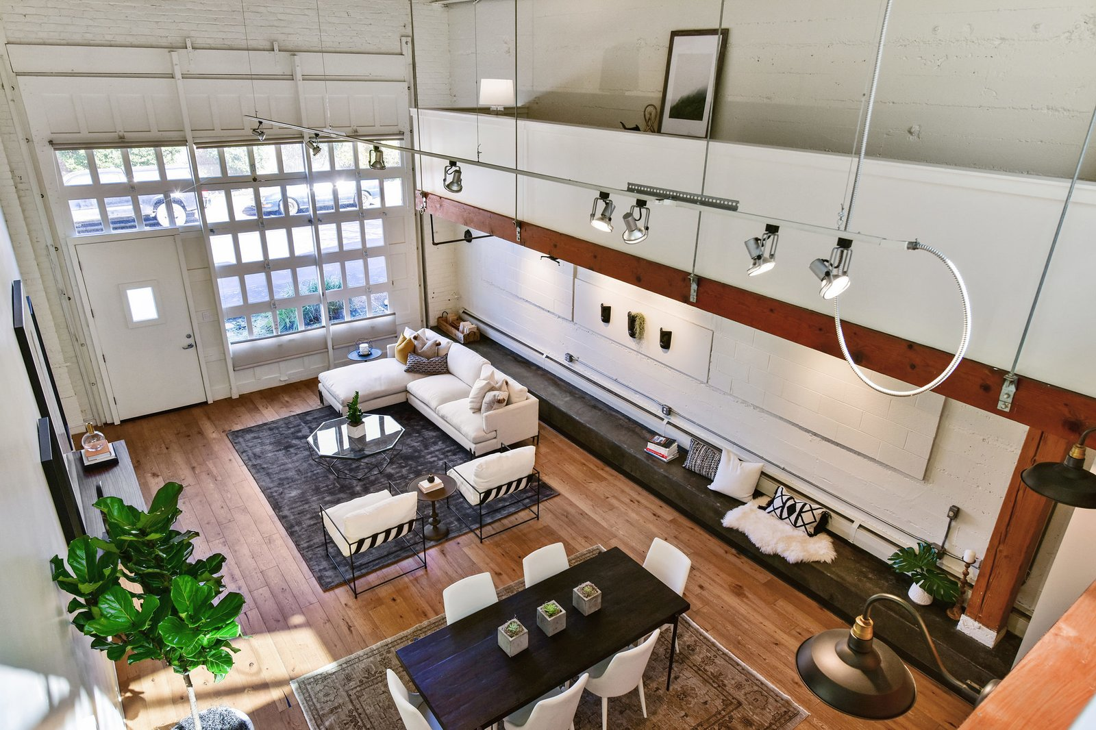A view of the lower level from up above.  Photo 9 of 9 in A Converted Warehouse Loft in the San Francisco Bay Area Seeks $950K