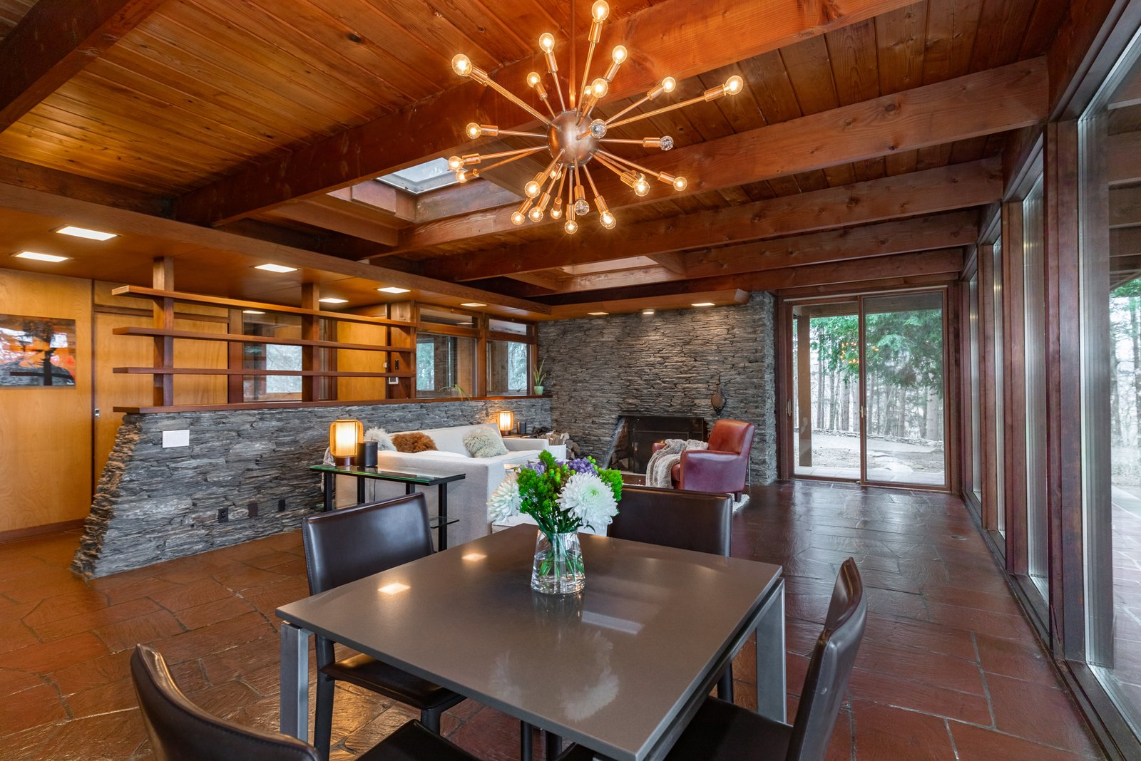 The open-plan communal area also includes a small dining space in the corner.  Photo 4 of 8 in A Midcentury Retreat by Architect and Usonia Founder Aaron Resnick Lists for $999K