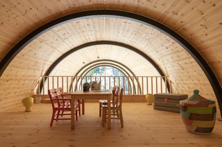 """A view of the beamed interior from the loft is almost hypnotizing. """"Functions and daylight float through the house, creating an extraordinary spatial atmosphere,"""" says Valbæk."""