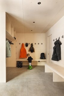 A large mudroom provides a practical space for changing and storing winter gear.