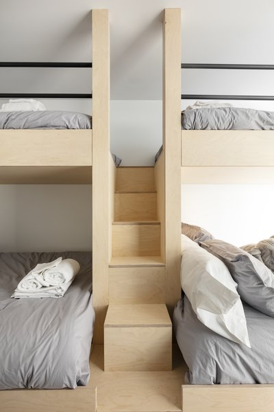 A look at the dorm-like sleeping area, complete with custom bunks to accommodate six guests.