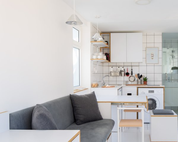 Designer Elie Metni created The Shoebox, a micro-flat tucked along the top floor of a historic building in Beirut. Her clients imagined the space to comfortably sleep two adults, while accommodating dinner or entertaining for up to five.