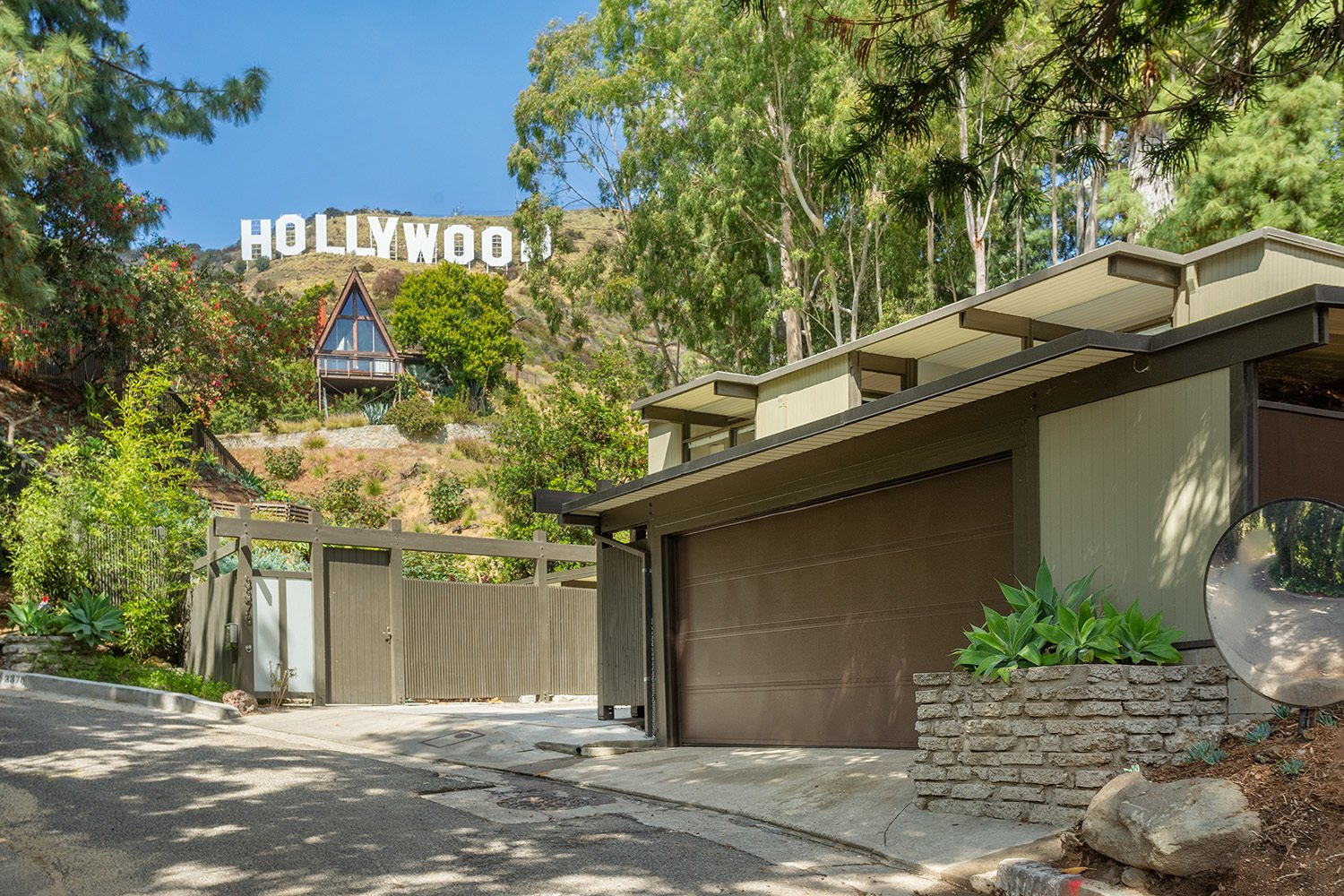 Nate is currently marketing Robert Malinoff's 1958 Beachwood Canyon residence.  Photo 1 of 17 in A Dapper Midcentury Under the Hollywood Sign Lists for $1.65M