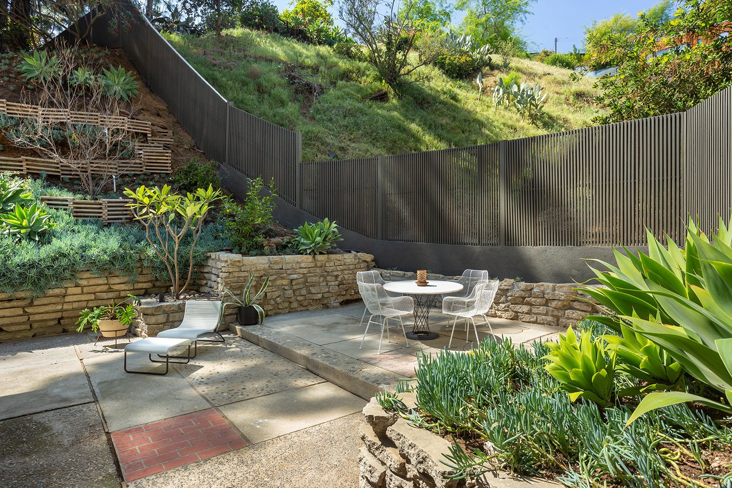 The patio continues to the front of the home, where an enclosed courtyard provides additional outdoor space for entertaining or relaxing.  Photo 17 of 17 in A Dapper Midcentury Under the Hollywood Sign Lists for $1.65M
