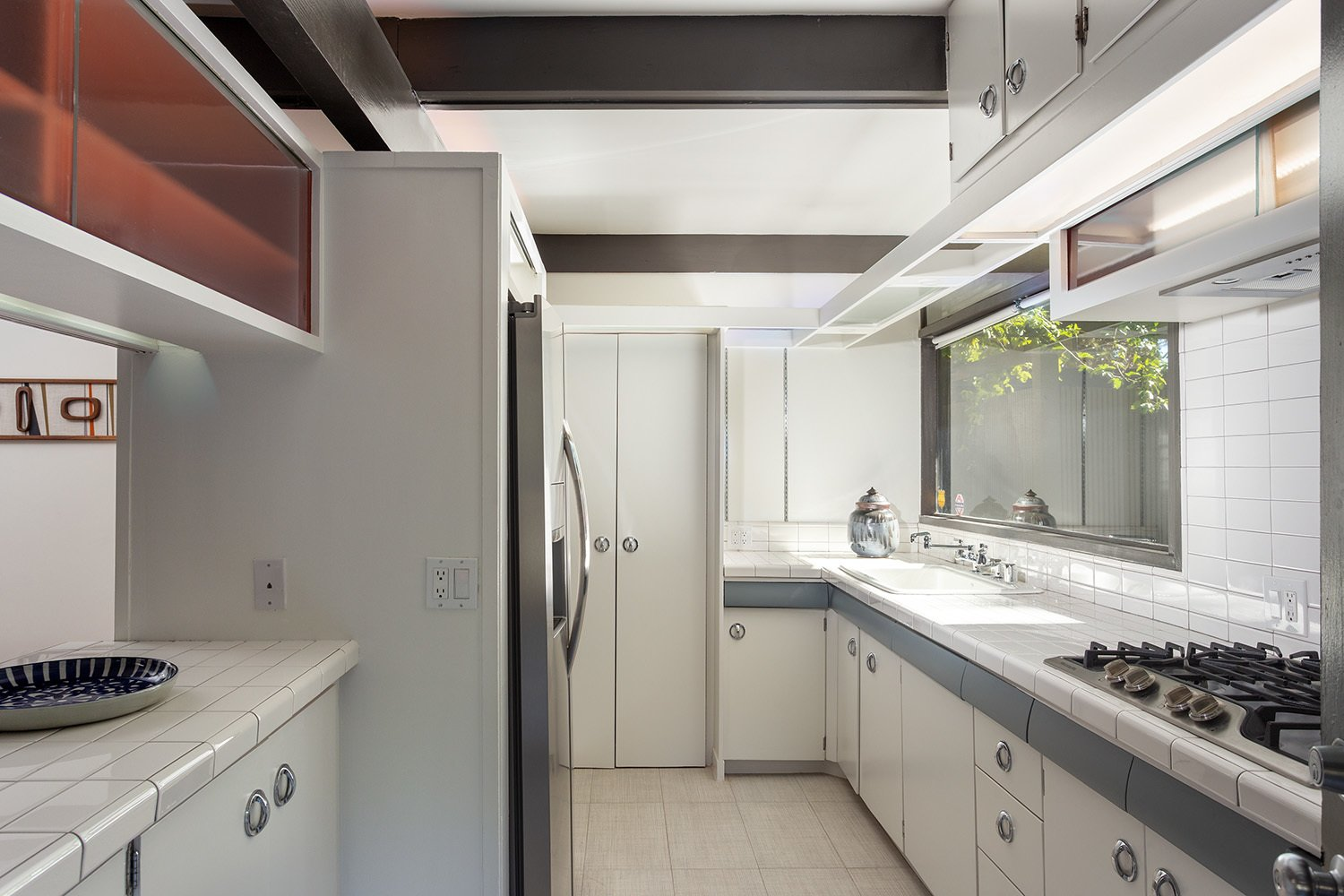 Another look at the kitchen. A small passthrough connects to the living room.  Photo 10 of 17 in A Dapper Midcentury Under the Hollywood Sign Lists for $1.65M