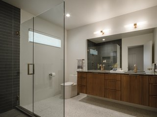 The master bath includes a floating double-vanity, teak cabinets, and an oversized shower.