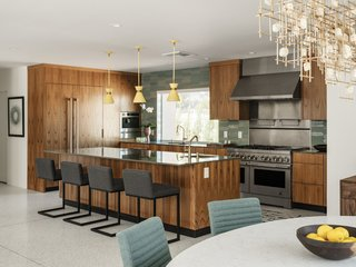 The state-of-the-art kitchen features teak cabinetry, a large island, and all-new appliances.