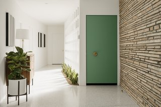 Burns was inspired by naturalistic elements in Frank Lloyd Wright's work. Natural Arizona sandstone runs along exterior and interior walls while in-ground planters dot the entryway.