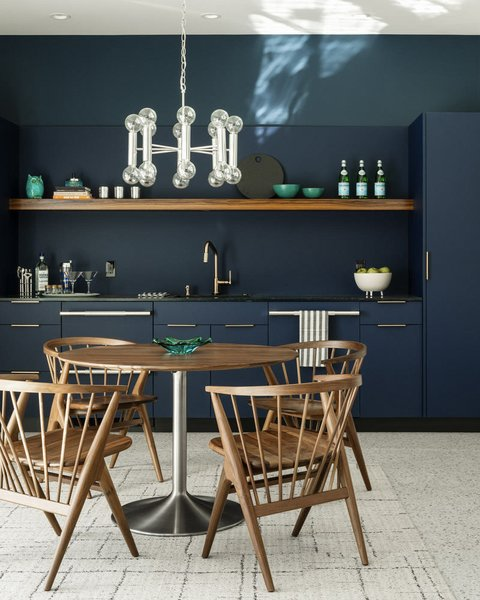 Dark blue cabinetry adds a dramatic flair in the kitchen of the guest house.
