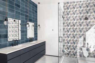 Floral tiles bring pattern and a peaceful color palette to this bathroom.