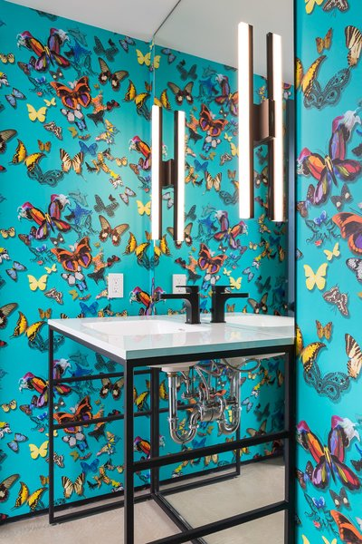 Colorful wallpaper creates a surprise in the powder room.