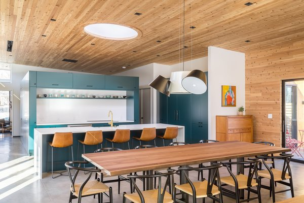 The curved wood ceiling leads to a large oculi that brings in all-day sunshine and reinforces the home's connection between inside and out.