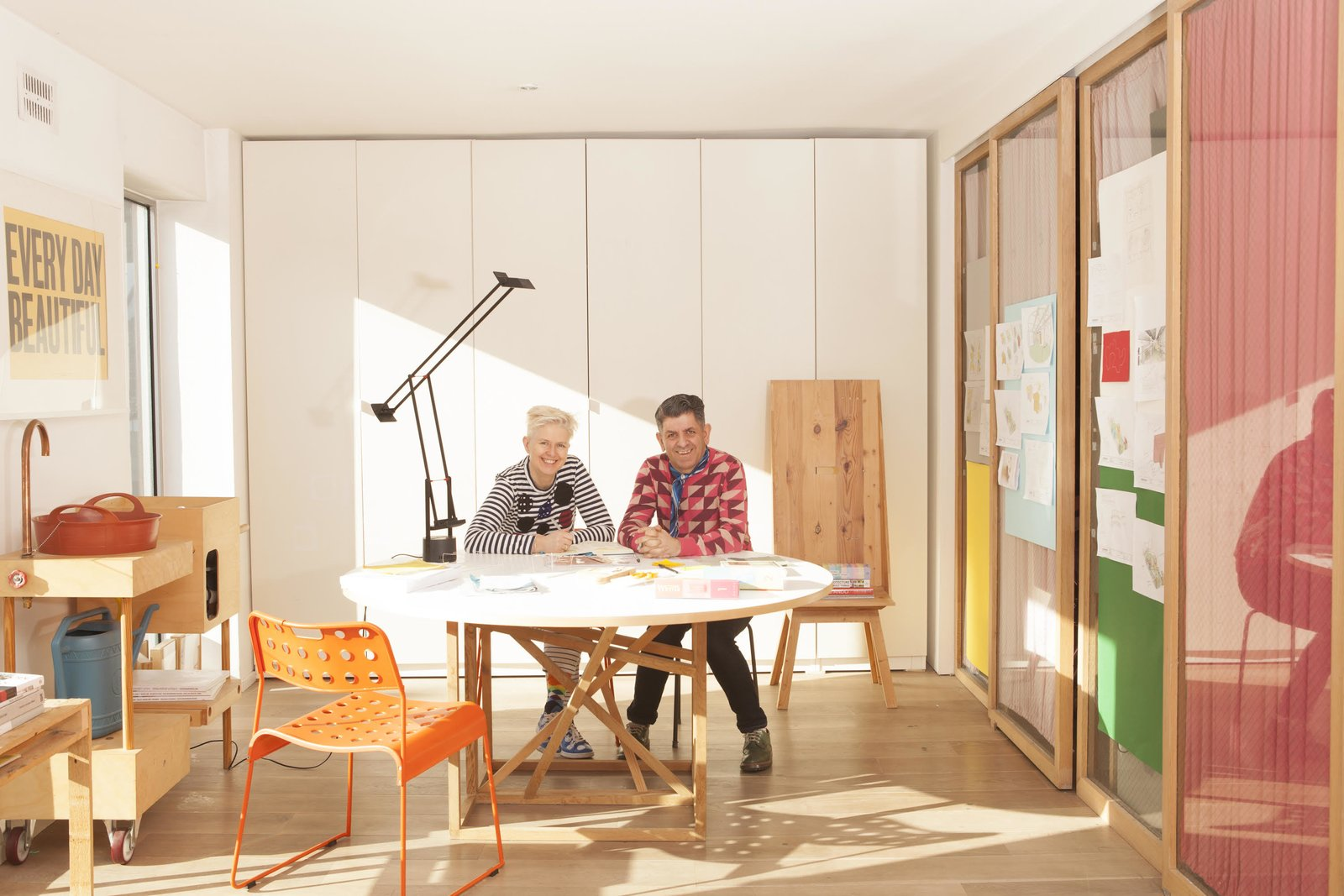 Nina Tolstrup and Jack Mama of London-based Studiomama, pictured here in their studio, start their day with morning yoga.  Photo 4 of 10 in How to Strike a Work/Life Balance in a Tiny Apartment, According to Design Experts