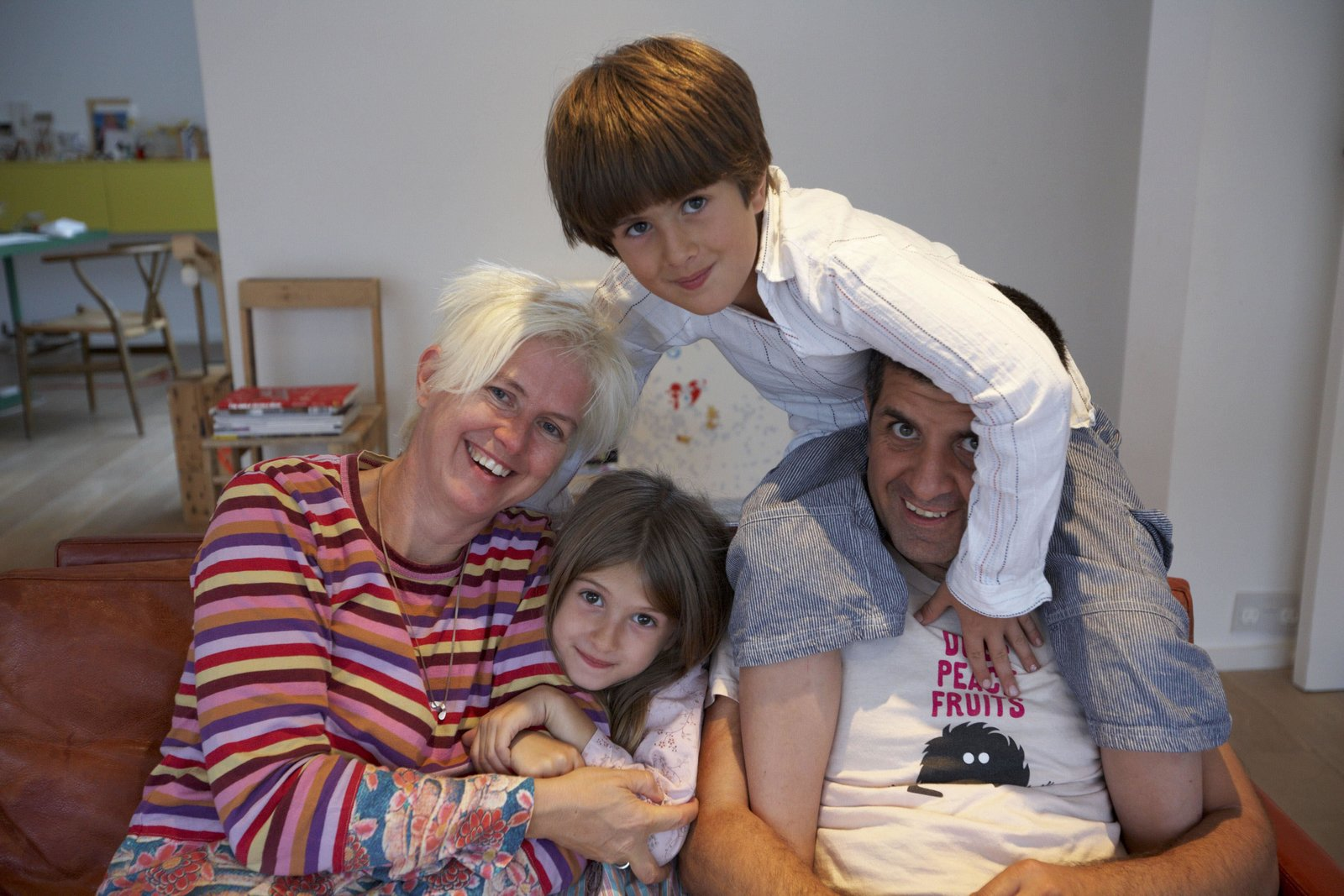 Nina Tolstrup and Jack Mama pose with their two children, Otto and Lula.  Photo 8 of 10 in How to Strike a Work/Life Balance in a Tiny Apartment, According to Design Experts