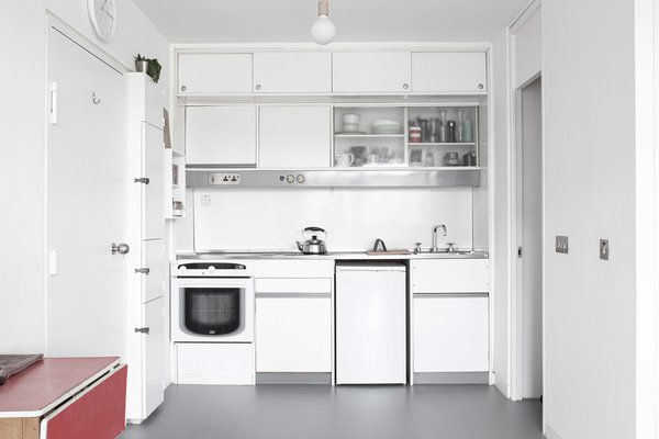 A small kitchen tucked in the corner received cosmetic updates during the renovation.