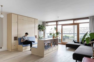 With a budget of £10,400 (approximately $13,000), Intervention Architecture transformed a tiny apartment into a minimalist studio. The firm worked with a cabinetmaker to design a custom unit and centerpiece for the space.