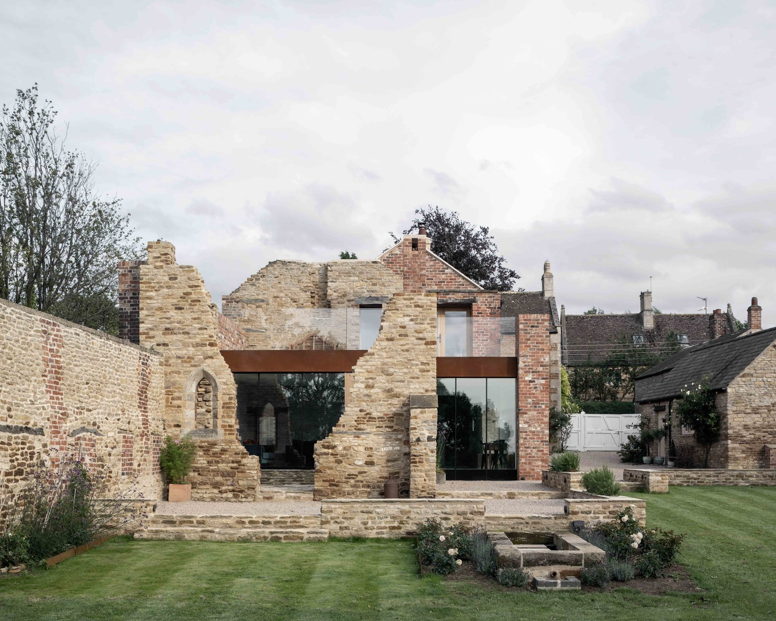 Will Gamble Architects revived a crumbling, 17th-century structure with a svelte addition of steel, brick, and glass. The disorderly nature of the ruin is juxtaposed against the modern structure, which expands a Victorian-era residence. The facade's brickwork was largely completed using reclaimed materials, allowing the new section to sensitively blend into its surroundings.