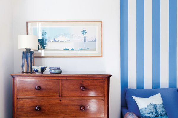 Hand-painted stripes are another way to add a decorative layer to an interior space. 2LG Studio recommends choosing a contrasting color for the stripes to create maximum impact with minimum effort.
