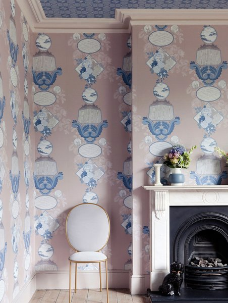 """This highly decorative dining room features complementary patterned wallpapers from the 2LG Studio collection for Graham & Brown. """"Because ceilings are above your eyeline, using a patterned wallpaper can give life to a space without being overwhelming,"""