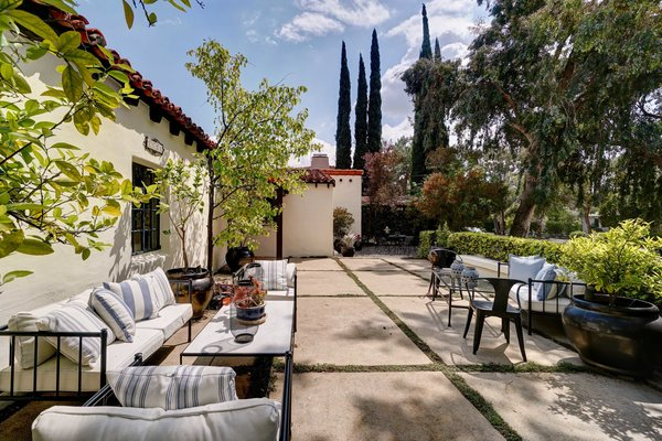 The 1,825-square-foot home is located close to the famous Arroyo Rose Bowl. Past trimmed hedges in the front yard, an expansive outdoor seating area offers a private corner to gather.