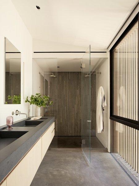 Slats along the facade filter natural light into the master bathroom.