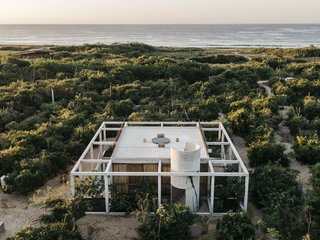 On a rustic strip of coastline near Puerto Escondido, Mexico, S-AR designed a beach getaway with an open concrete grid that frames its natural surroundings.