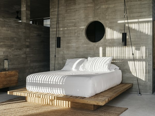 The bed linens are from Luuna and the pendants were designed by Claudio Sodi.
