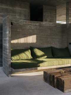 Couch cushions designed by S-AR offer plush seating in the living area.