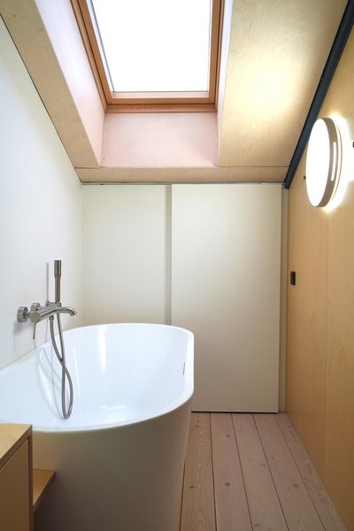 A second bathroom hides behind the lofted closet.