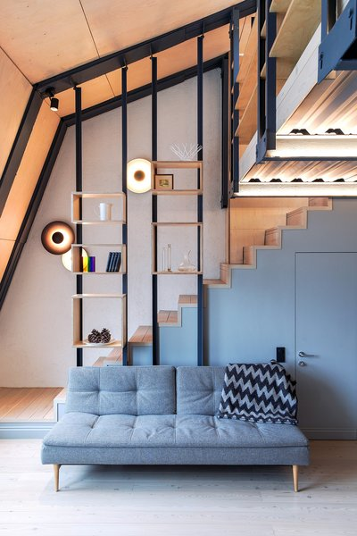 The dimmable round sconces climbing up the staircase are from Marset.