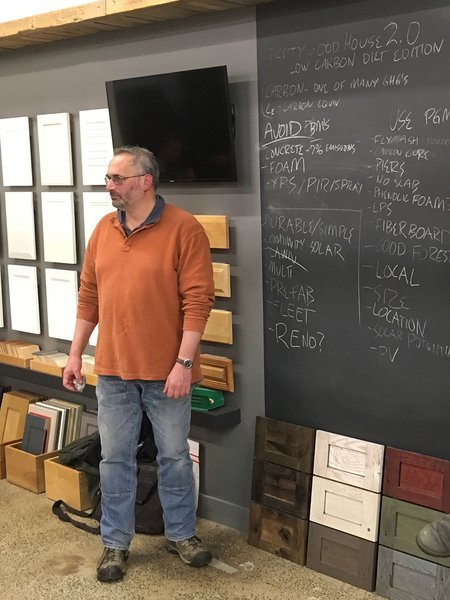Homebuilder Dan Kolbert moderates a Pretty Good House meeting at Performance Building Supply in Portland, Maine. Here, they discuss ways to lower a home's carbon footprint.
